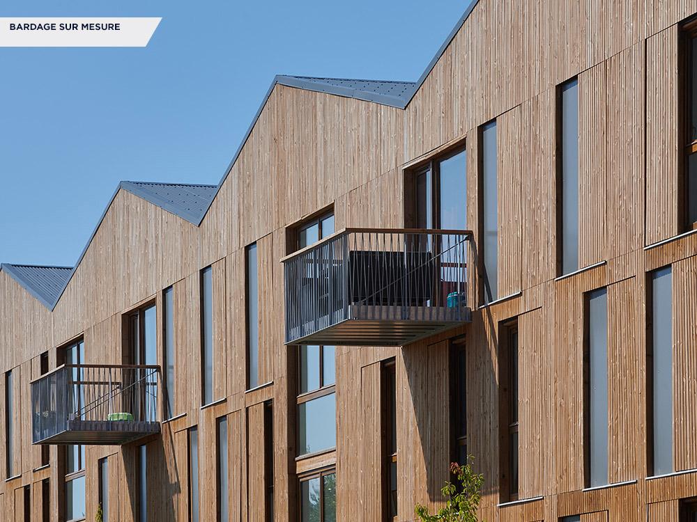 Bardage sur mesure impregnation marron - Parc Erdre, Nantes - Architecte : Tank Architectes Lille (59)